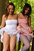 Jodie Gasson and her sister, Kelly, strip out of their dresses, in the sunshine