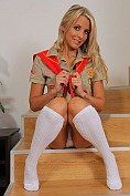 Cheeky blonde cookie girl looks amazing as she strips out of her uniform and flaunts her hot body in just knee high sock