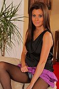 The lovely Chrystal Lee looks fantastic in her black silk top and tiny purple miniskirt