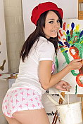 Pretty artistic teenager painting her body