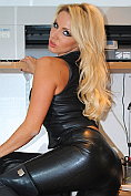 Dannii in kinky black leather