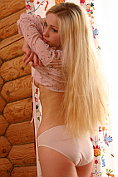 Blonde teen Holli Paige strips naked for us
