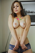 Miren shows off her fabulous tits before taking off her knickers as well