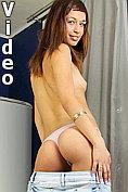 Tall brunette cutie Savina slips her fingers in her pussy