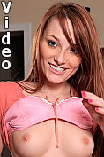Flirtatious young lady strips and masturbates on a table top