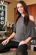 Tall slender brunette sucks on her dildo before riding it on the counter