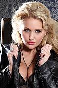 Vanessa Walker wears her sheer black teddy under her leather jacket