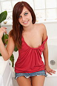 Petite brunette Maryjane Johnson exposes her small tits and tender pussy