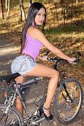 Davon Kim rides her bike in the woods