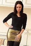 Clare R ready for a night out in her gold miniskirt and tight top