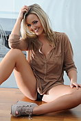 Jodie Gasson looks lush in her large brown top and black panties