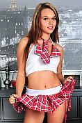 Naughty Nubile schoolgirl slips off her red thong to show us her tender pussy