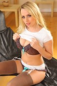 Holly Gibbons strips down to her stockings and suspenders