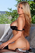 Randy Moore shows off her impeccable body in black lingerie and stockings