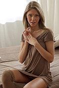 An angelic horny teenager pleasures her hot body