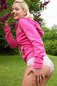 Lovely teen Pinky June posing naked outdoors