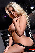 Busty blonde babe Stacey Robyn teasing in black fishnet lingerie