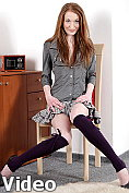 Petite redhead slips off her school uniform and masturbates on her desk