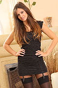 Louisa Marie looking quite tarty in her short black dress and layered nylons