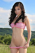 Cute teen with long legs gets naked by the roadside