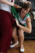 Cheerleader Cate getting stripped by another babe