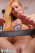 Petite strawberry blonde fingers her slicked up pussy