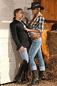 Two fine frisky babes fuck in the farm yard