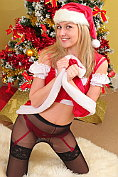 Nikki Friend in her Christmas costume complete with stockings and suspenders and tights
