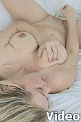 Big titted blonde excites her bald pussy with her fingers