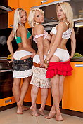 Thee beautiful blonde lesbian beauties stripping and posing in the nude in the kitchen