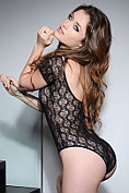 Jessica Impiazzi peels out of her black see-through bodysuit on the stairs
