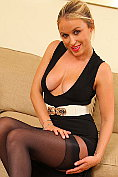 Busty blonde babe Rosie Whiteman shows off her layered nylons