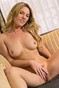 Seductive babe stimulates her swollen clit with a vibrator