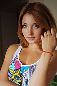 Beautiful redhead Kika takes off her bra and knickers and poses naked
