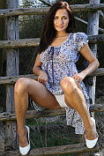 Michaela Isizzu takes off her dress and her knickers before opening her legs for us