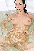 Busty babe Jenya D (Katie Fey) lets us watch her in the bath