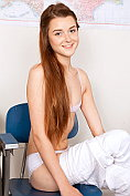 Slender teen Alex Mae strips in the classroom