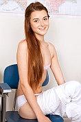 Slender teen Alex Mae strips in the classroom