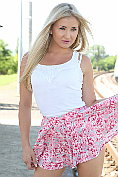 Slim blonde babe Cayla Lyons shows off at the station