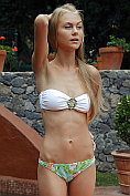 Nancy A takes off her bikini and shows off her lithe body by the pool