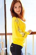Gorgeous redhead Leona Honey undresses for us