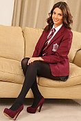 Abigail B teases as she takes off her school uniform for us