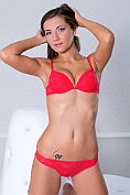Russian beauty Quenna takes off her red bra and knickers and opens her legs for us