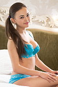 Kiki takes off her matching blue bra and knickers set