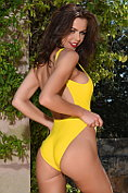 Jennifer Ann shows off in her bright yellow one-piece swimsuit