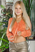 Beautiful blonde Xena is not wearing anything under her top or shiny trousers