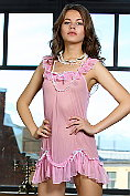 Danielle takes off her pink negligee and gets back on the bed to wait for you