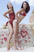 Beautiful teens Korica A and Milena D make out on the rocks