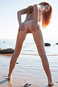 Fabulous redhead Michelle H makes a right exhibition of herself at the seaside