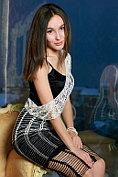 Belonika is naked under her sophisticated evening dress